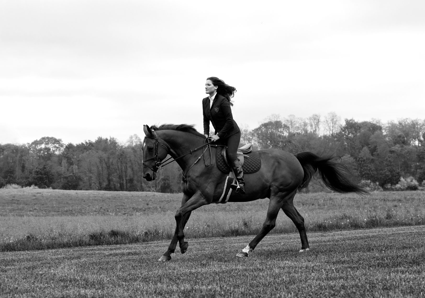 Editorial Woman riding horse by Abbey Drucker in black and white