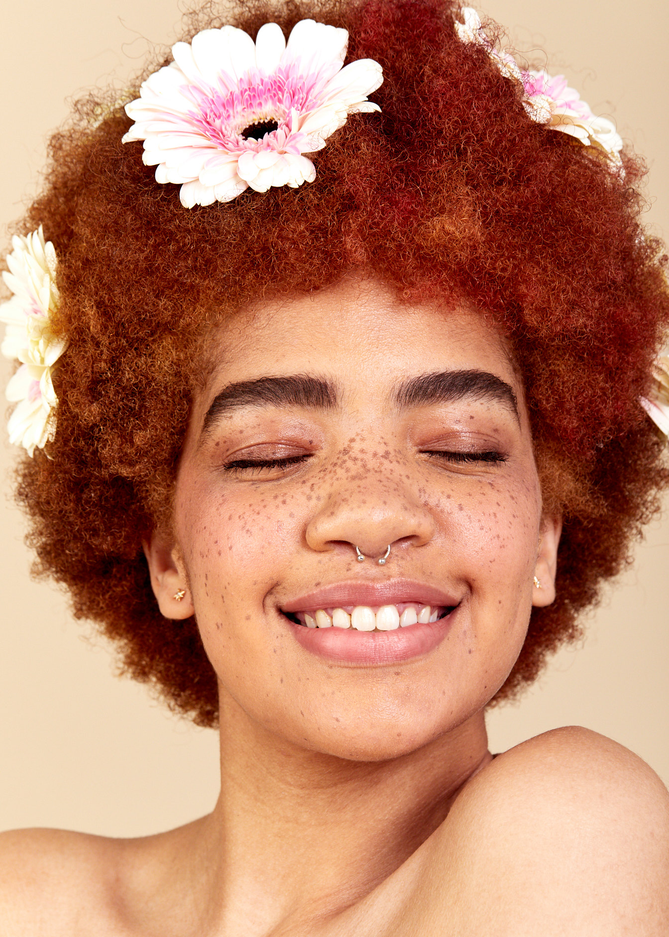 No retouching portrait of girl smiling with flower in her hair.