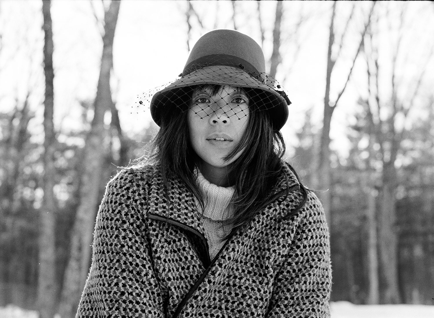 Kazu Makino of Blonde Redhead winter portrait outdoors in vintage hat and overcoat by Abbey Drucker in black and white